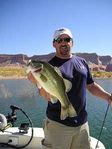"""Keith Kimball from Richfield, Utah, caught this 4-pound largemouth bass in Warm Creek on a """"sammy"""" top water lure.  Fishing surface lures is a most exciting way to fish and top water fishing is peaking right now.  Photo courtesy of Mike McNabb."""