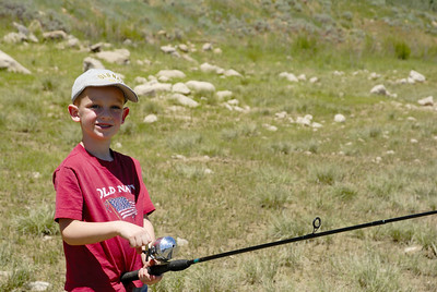 Luke Christensen, 5, of Salem poses with rod at Miller Flat Reservoir on 7-4-2007.  By Brent Stettler, Utah Division of Wildlife Resources.