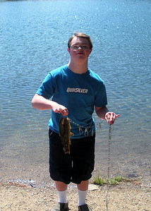 Brandon Turner. of Alpine, Utah, shows off the trout he caught at Petes Hole this past week.