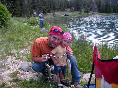 Richard Oman and Kalli Kay Oman 1.5 years old of Payson at Petes Hole holding a stringer of small trout