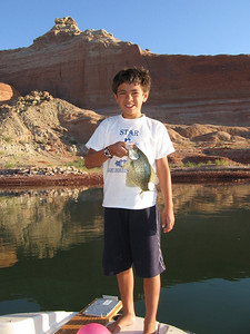 Jackson Thieme (10) of Middleton, Idaho displays his crappie from Lake Powell on 9-04-08.  By Utah Division of Wildlife Resources