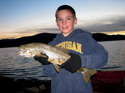 Troy Crider of Price, Utah with a large tiger trout he caught at Scofield Reservoir on October 30, 2008.  He and his dad and friends fished after sundown from a boat.  They threw dead minnows with marshmallows.  The bait was retrieved slowly.  Photo by Daniel Keller, Utah Division of Wildlife Resources