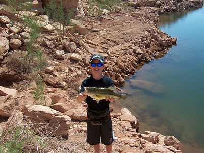 Austin Kimber of Delta, Colorado shows his largemouth bass caught from Bullfrog, Lake Powell, 4-10-07.  By Utah Division of Wildlife Resources.