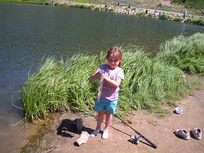 Kaitlyn Noyes, 5-years-old, of Price shows a stringer of trout caught at Boulger Reservoir with rainbow PowerBait.