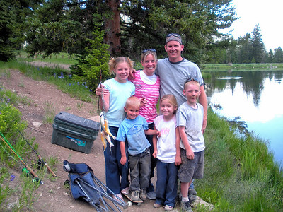 The Peterson family of Saratoga, Utah pose with a stringer of fish caught at Petes Hole, a small lake on the Wasatch Plateau in central Utah.