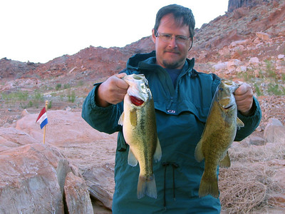 Bill Owens of Logan shows his largemouth bass catch from San Juan arm of Lake Powell, on 4-22-06.  By Utah Division of Wildlife Resources