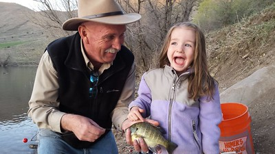 Phil Douglass fishing with his granddaughter at Mantua