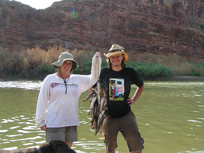 Bryce Johnson (L) and Orion Rogers (R) with a stringer of channel catfish caught from the Colorado River on 7-15-07. Photo by A J Rogers.