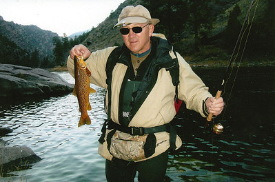 Brad Crompton shows fish caught on Green River.  By Brad Crompton, Utah Division of Wildlife Resources, 1-2-1998.
