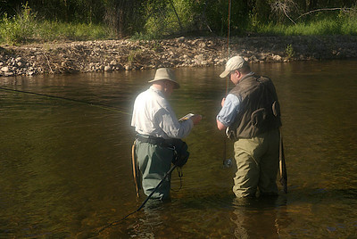 Teaching fly fishing and picking out a fly.
