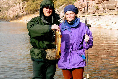 Gina Crompton and her father with a trout caught on the Green River. Photo by Brad Crompton, 1-2-1998.