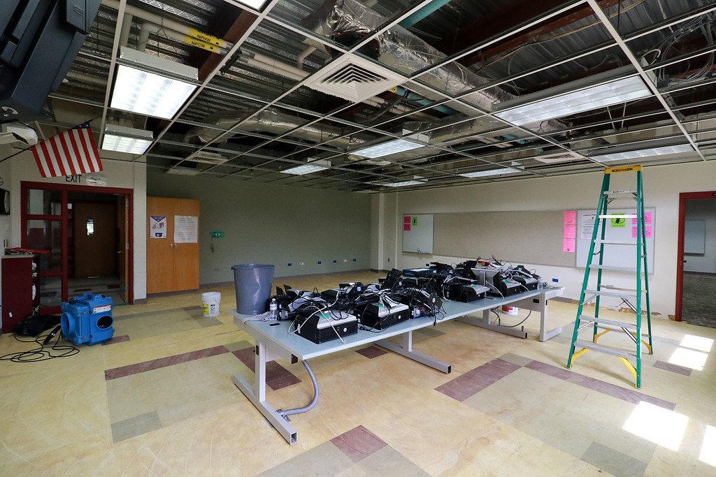 . A fish tank at Fitchburg High School caught fire on July 3, 2018. It caused damage to the room it was in and a lot of smoke damage to other rooms and ceiling tiles. This computer room on the first floor is missing all of it\'s ceiling tiles and the rug had to be pulled up due to the smoke damage. SENTINEL& ENTERPRISE/JOHN LOVE