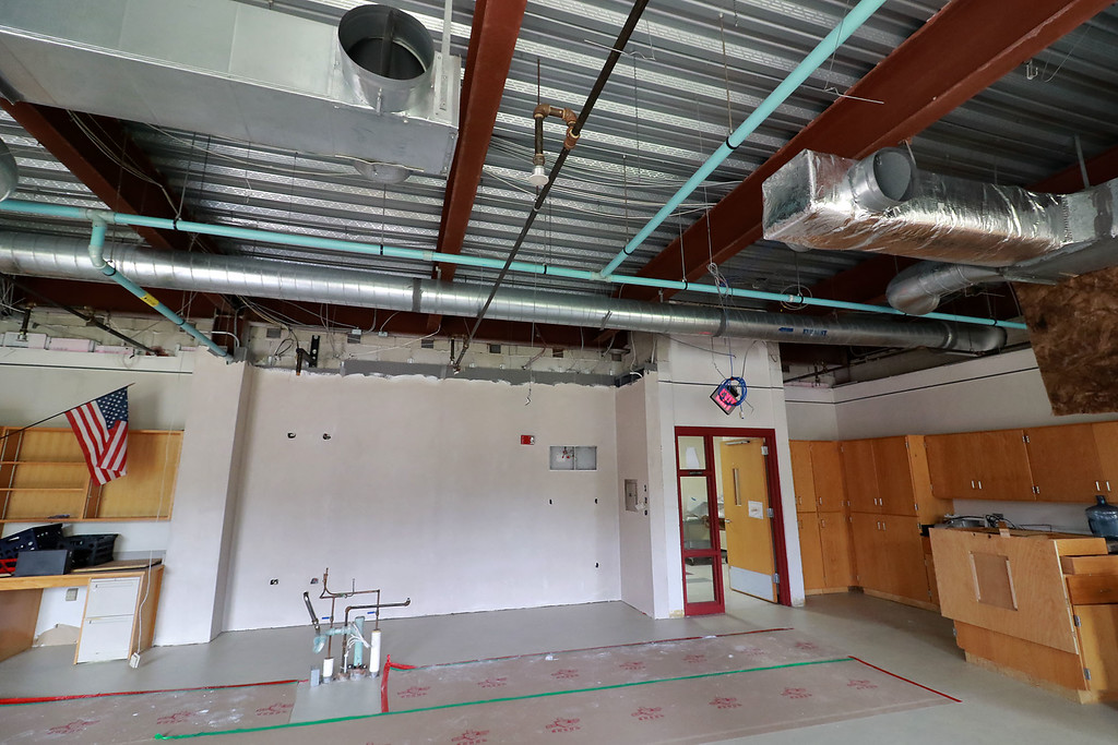 . A fish tank at Fitchburg High School caught fire on July 3, 2018. It caused damage to the room it was in and a lot of smoke damage to other rooms and ceiling tiles. This science room on the second floor is were the fish tank was. You can see that the wall  had to be replaced. The tank was in the right corner. The teachers desk, where the pipes on the floor are, was damaged and had to be removed. You can also see that the ceiling tiles in this room have to be replaced as well. SENTINEL& ENTERPRISE/JOHN LOVE