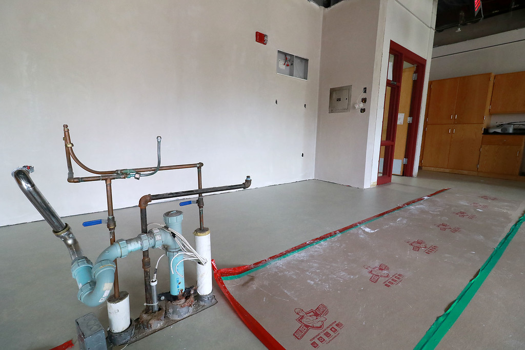 . A fish tank at Fitchburg High School caught fire on July 3, 2018. It caused damage to the room it was in and a lot of smoke damage to other rooms and ceiling tiles. This science room on the second floor is were the fish tank was. You can see that the wall  had to be replaced. The tank was in the right corner. The teachers desk, where the pipes on the floor are, was damaged and had to be removed. SENTINEL& ENTERPRISE/JOHN LOVE