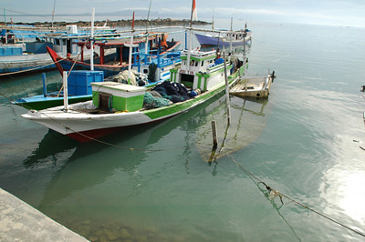 Kupang  - boats (and sunken boat) near fish auction place