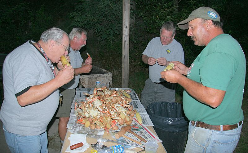 Fro left to right we have Joe Cassiani, Pete Johnston, Jim Conte and George Rigby.  Here they are chowing down on steamed crabs, clams, kielbasa, corn and potatoes.<br /> <br /> What a feast.<br /> <br /> Captain Al Lorenzetti