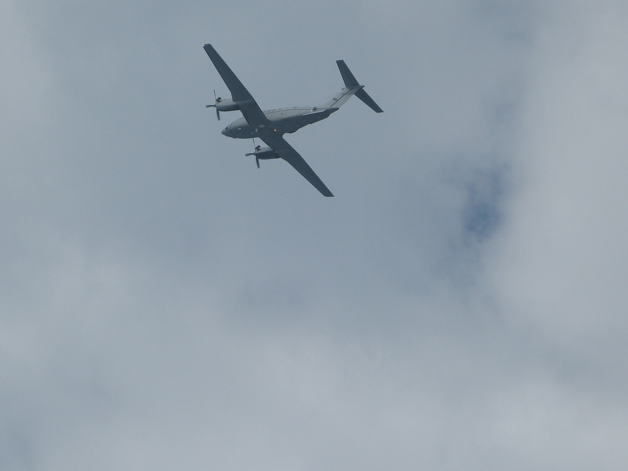 Always busy in the Bay on Friday.  Here is a huge twin prop job that just took off from North Island.