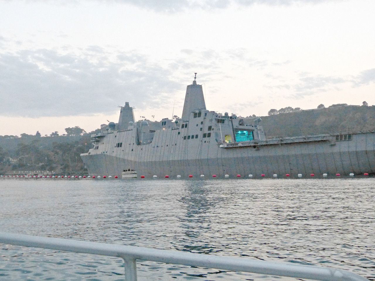 This, my dear Fan, is the USS San Diego!  Yes, indeed.  A San Antonio Class amphibious transport dock, she is home-based right here in her name-sake city, and is also known as LPD-22.<br /> <br /> The class's increased vehicle and substantial cargo carrying capacity will make it a key element of 21st century Amphibious Ready Groups, Expeditionary Strike Groups, or Joint task forces. The ships of the new class integrate the latest in shipbuilding and warfighting technologies to support current and future Marine Corps aircraft, and both air cushion or conventional landing craft.<br /> <br /> The San Antonios are designed to be the most survivable amphibious ships ever put to sea  [what contractor would ever advertise their ship design could be easily sunk?]. The design incorporates state-of-the-art self-defense capabilities; and includes facilities for Command and Control, Communications, Computers, and Intelligence (C4I); and reduced radar cross-section signature technologies. Reduced operational costs and an improved capability to incorporate technological advances over its 40-year service life are also essential design objectives.  [we'll see how that pans out]