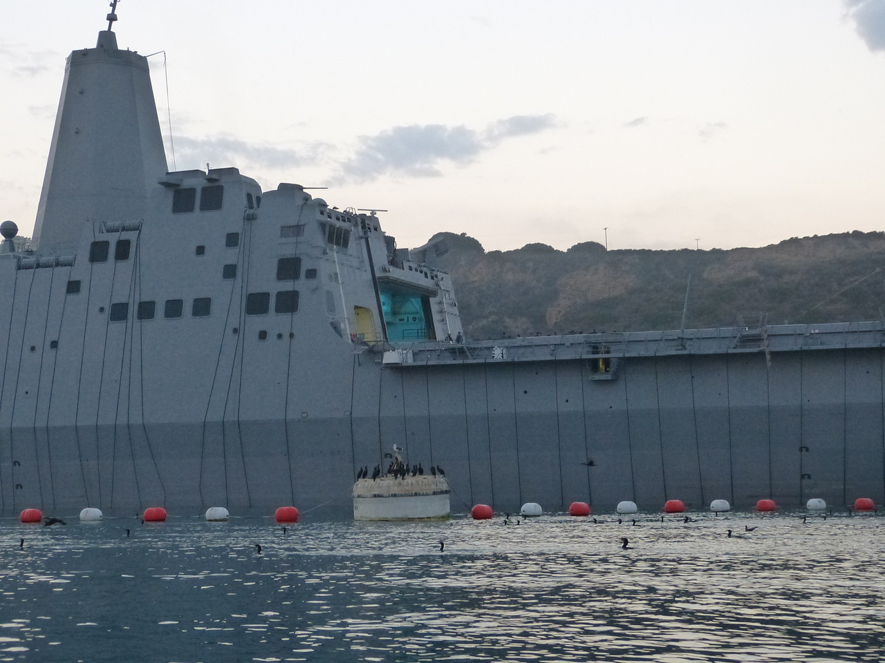The Advanced Enclosed Mast/Sensors, which enclose the ship's radars and communications antennas, characterize the ship's distinctive profile<br /> <br /> See all those ropes down the side?  One could hardly imagine that she needs any scrubbing or paint, since she was only commissioned in May of 2012.  She became the first ship in the San Antonio class to locally fire the MK 46, 30 millimeter gun weapon systems.