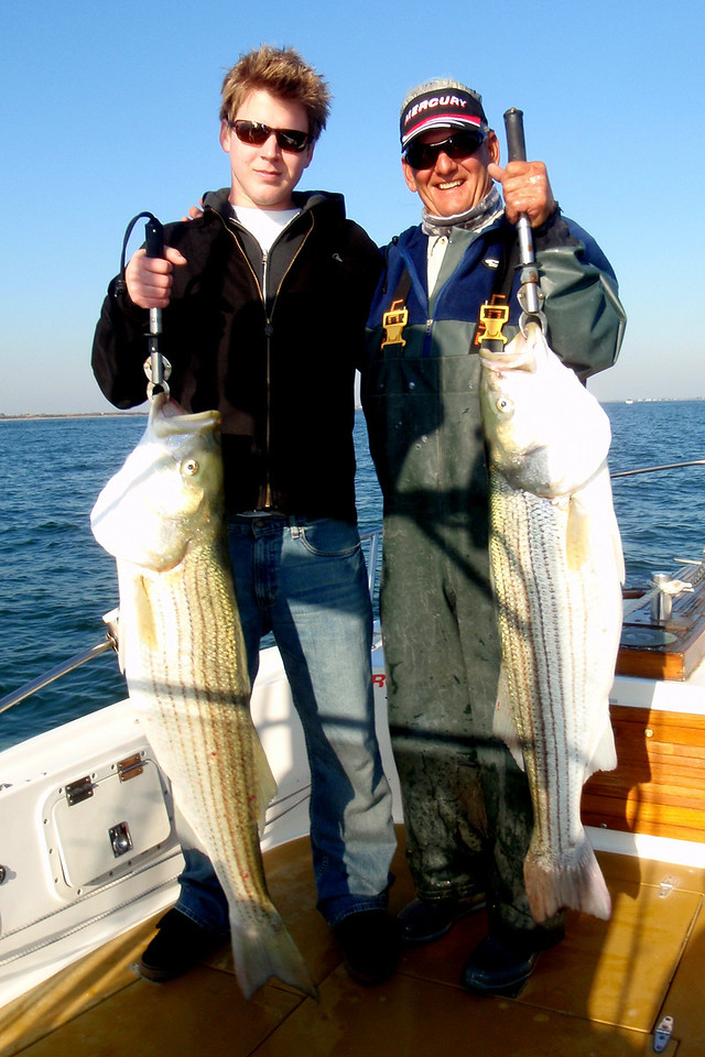 Russell Hurd and Captain Al with a couple of nice bass on a short afternoon trip.