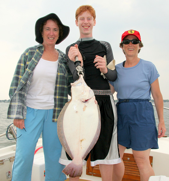 Lynn Aaron and Ande with a beautiful big fluke.