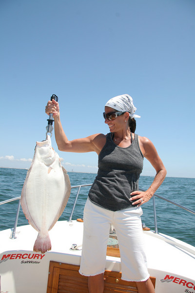 Gina Stollerman with a 10 pound fluke.