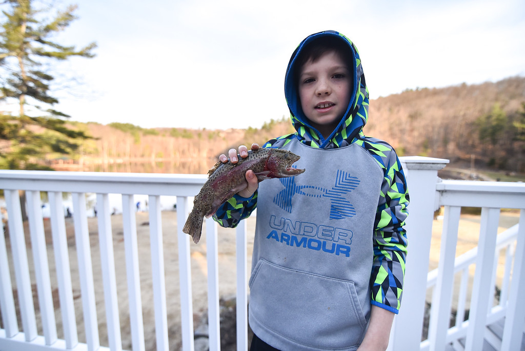 . (04/14/18 LEOMINSTER MA) Trevor Pellecchia, 11, of Leominster holds one of the first catches of the day during Saturday\'s fishing derby held at Barrett Pond in Leominster.  SENTINEL & ENTERPRISE JEFF PORTER
