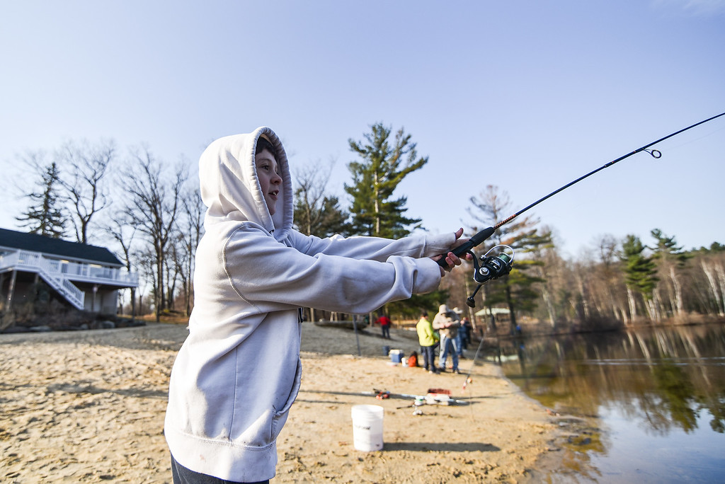 . (04/14/18 LEOMINSTER MA) James O\'Sullivan, 12, of Leominster cast his reel for Saturday\'s fishing derby held at Barrett Pond in Leominster.  SENTINEL & ENTERPRISE JEFF PORTER