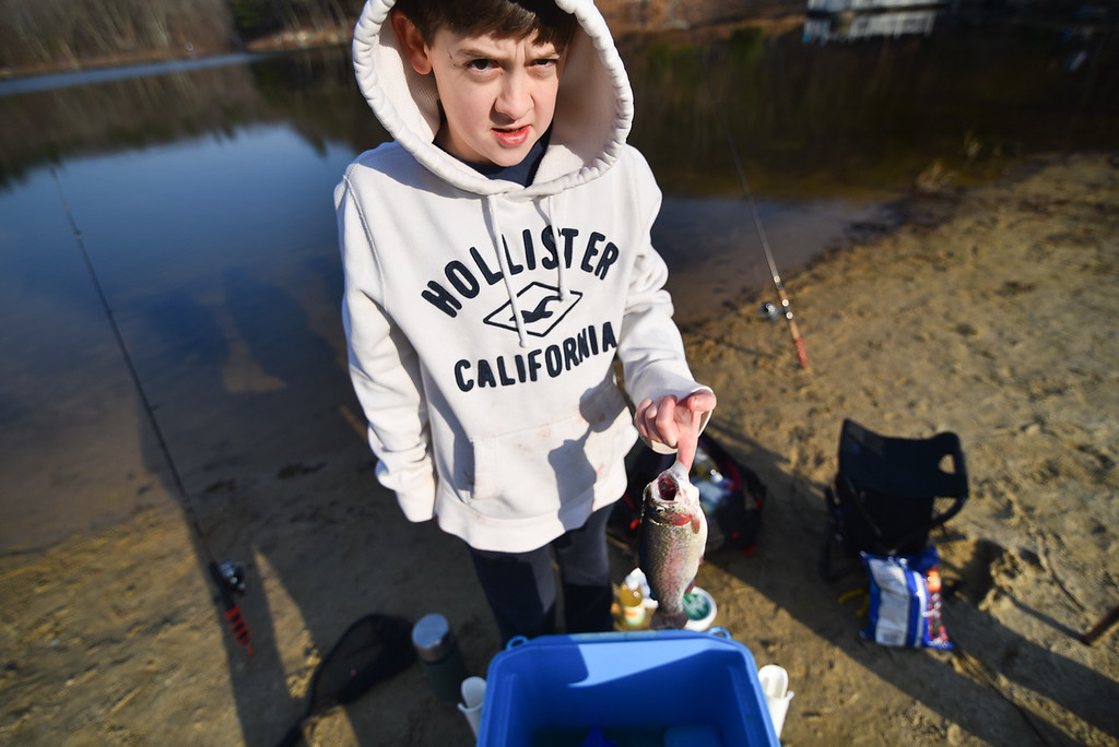 . (04/14/18 LEOMINSTER MA) James O\'Sullivan, 12, of Leominster shows off his catch, one of only a few out of the 70 or more participants, for Saturday\'s fishing derby held at Barrett Pond in Leominster.  SENTINEL & ENTERPRISE JEFF PORTER