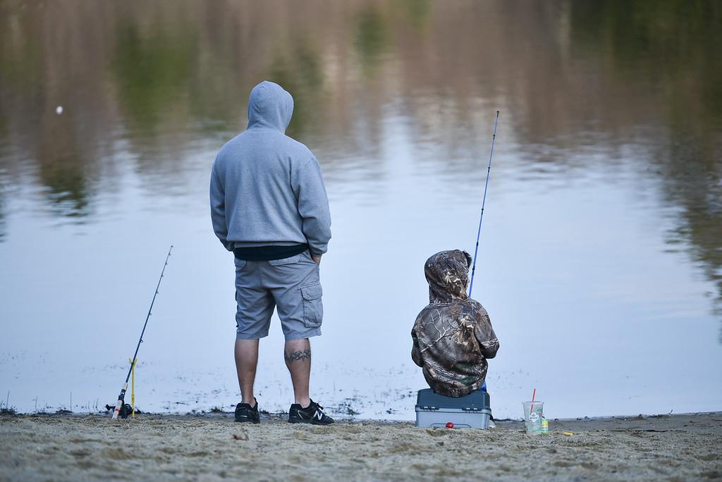 . (04/14/18 LEOMINSTER MA) KId\'s fish alongside family for Saturday\'s fishing derby held at Barrett Pond in Leominster.  SENTINEL & ENTERPRISE JEFF PORTER
