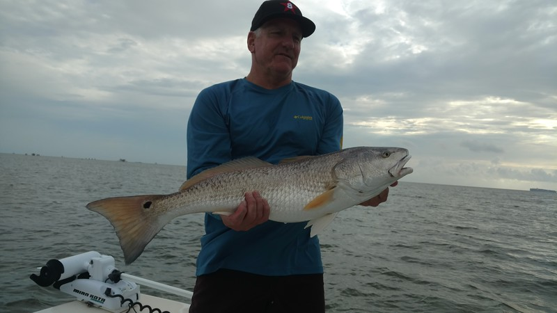 Tom Montaque with Redfish