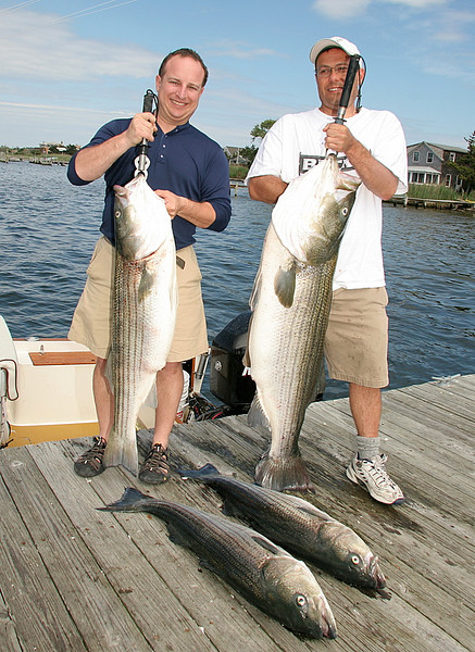 Her we have Jim and Greg with a 30 pound fish that is dwarfed by the big 54.  We had a great time with beautiful weather.  One fish was on a plug today and the rest on bait.<br /> <br /> A wonderful time on the water with great guys.<br /> <br /> Captain Al Lorenzetti