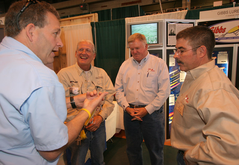 3/1/2007<br /> <br /> Tom Melton of the Fisherman Magazine and Capt. Al are talking with Dennis Ryan (president)and Dan Smalley (head engineer)of Gibbs Lures.  Tim Smith and Captain Al Lorenzetti spent the day at the Suffern Outdoor show today visiting with friends and checking out all the latest on the fishing and hunting scene.  I find it very satisfying to be able to talk to the experts and more specifically the owners of companies whose products I use in the course of my fishing and hunting activities.  Today was a great example of this as I had the opportunity to talk to the president of Gibb's Lures and his head engineer about the plugs that I use.  I was able to share my experiences in using these plugs and was able to suggest possible improvements and tell them about how their product did or did not fulfill my expectations.  They were very receptive to my input and wanted to know about my experiences with their product.
