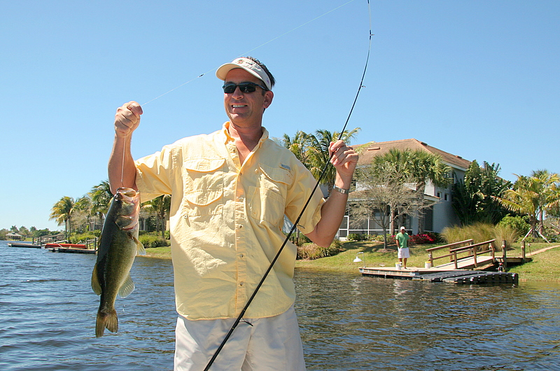 Bob Rommel with a nice bass caught about 20 yards from his buddy Sean's house on Fiddler's Creek.<br /> <br /> Captain Al Lorenzetti