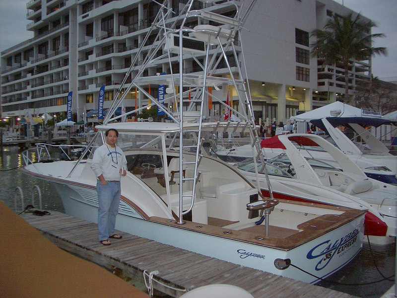"""And finally a boat which exhibited all the items I love to see when I  waste those hours wandering the docks....the flare, the tumble home and the beautiful teak.  (and he's not bad too!)   <a href=""""http://www.calyberboatworks.com"""">http://www.calyberboatworks.com</a><br /> <br /> Next year persuade your girlfriend, wife or significant other there is plenty to keep her interested at the Miami International Boat Show, its a perfect time of year to get away from the depths of winter here and hopefully you come home with something great!<br /> <br /> Rosa Mearns"""