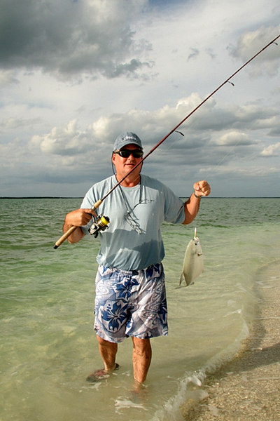 Here is Tom, Wes's father-in-law, with a nice pompano caught from the beach.