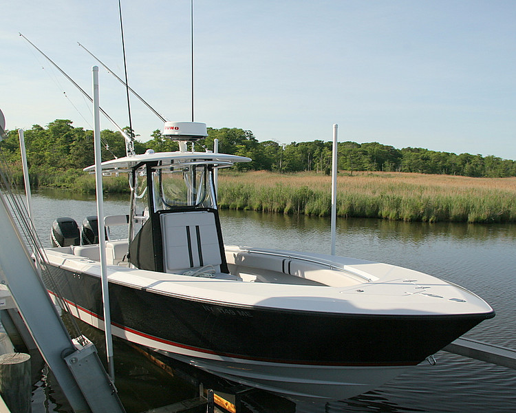 Here is the boat. 27 Contender, 300 Merc Verados, Graphite outriggers, black hull, gray topside and red trim to match the Mercury colors.<br /> <br /> Great fishing boat.<br /> <br /> Captain Al Lorenzetti