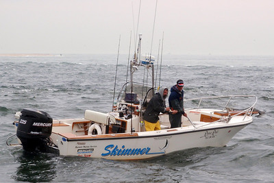 A friend Steve Neary and his fishing buddy Buddy Robinson were nearby when Joe was fighting the big fish. Steve was kind enough to take some great photos of the fishing scene.  Here Joe is working the fish to the side of the boat.