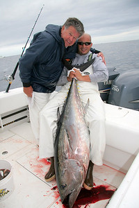 9/22-23/2009  I had two great days of fishing for tuna. On 9/22 I fished with Mike DeSimone and Captain Dave Zarrello on Mike's 32 regulator.  We found the fish in a dragger fleet about 50 mile from Fire Island Inlet.  We jigged and chunked big tuna all day. It was awesome.  On 9/23 I fished with Captain Roger Dean and Captain Dave Zarrello on Dave's 25 Contender for another go at the tuna. We had another awesome day with fish to 150 pounds.  Here is Dave and Roger celebrating after the catch.