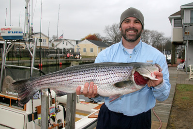 11/19/2009  I fished today with Mark Epstein and Dave. We had a good day of catching striped bass and bluefish on jigs in the ocean.  Here is Dave with a nice bass taken on an AVA 47 green tail.