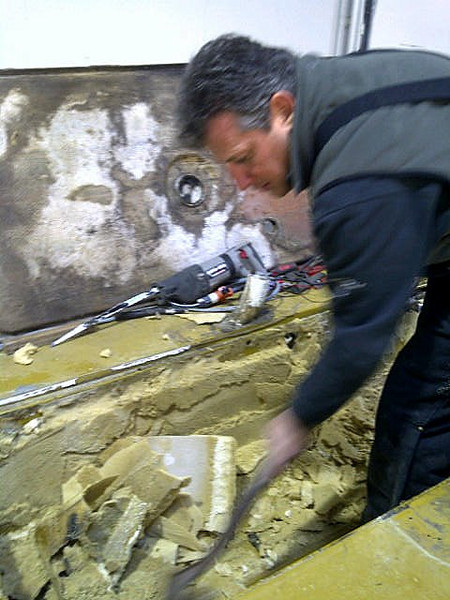 George removing all old wet foam from the coffin to clean it up.