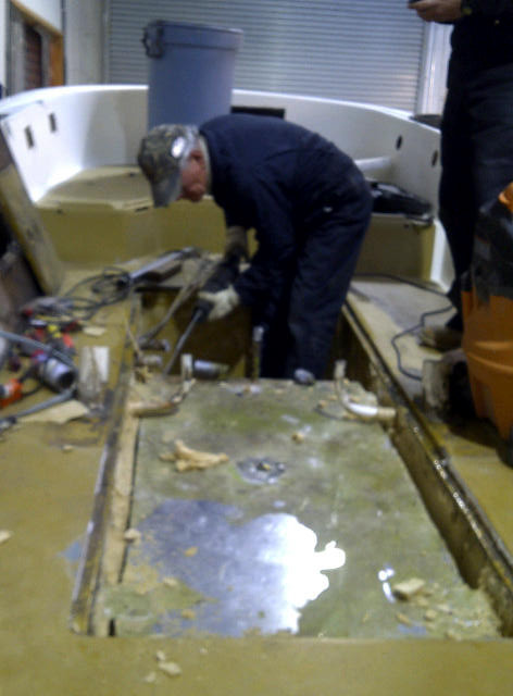 Removing the gas tanks from Tony's boat or any boat is a tough job.