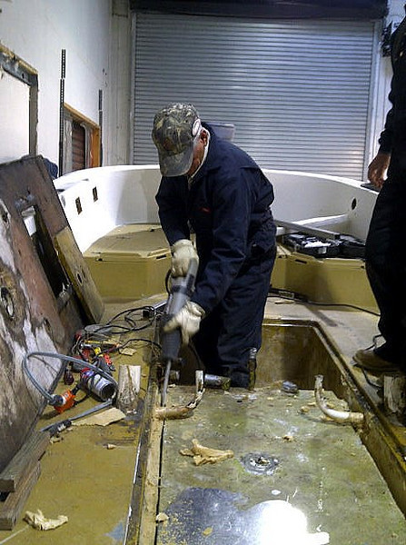 They are locked in by foam and there is only about one inch of working space between the tank and the coffin.<br /> <br /> The best tool is a sawzall. We had two 12 inch blades tack welded together to make a blade 16 inches long. This made the separation along the walls.