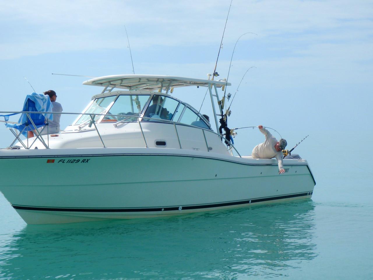 Craig Georgi pulling in a fish.