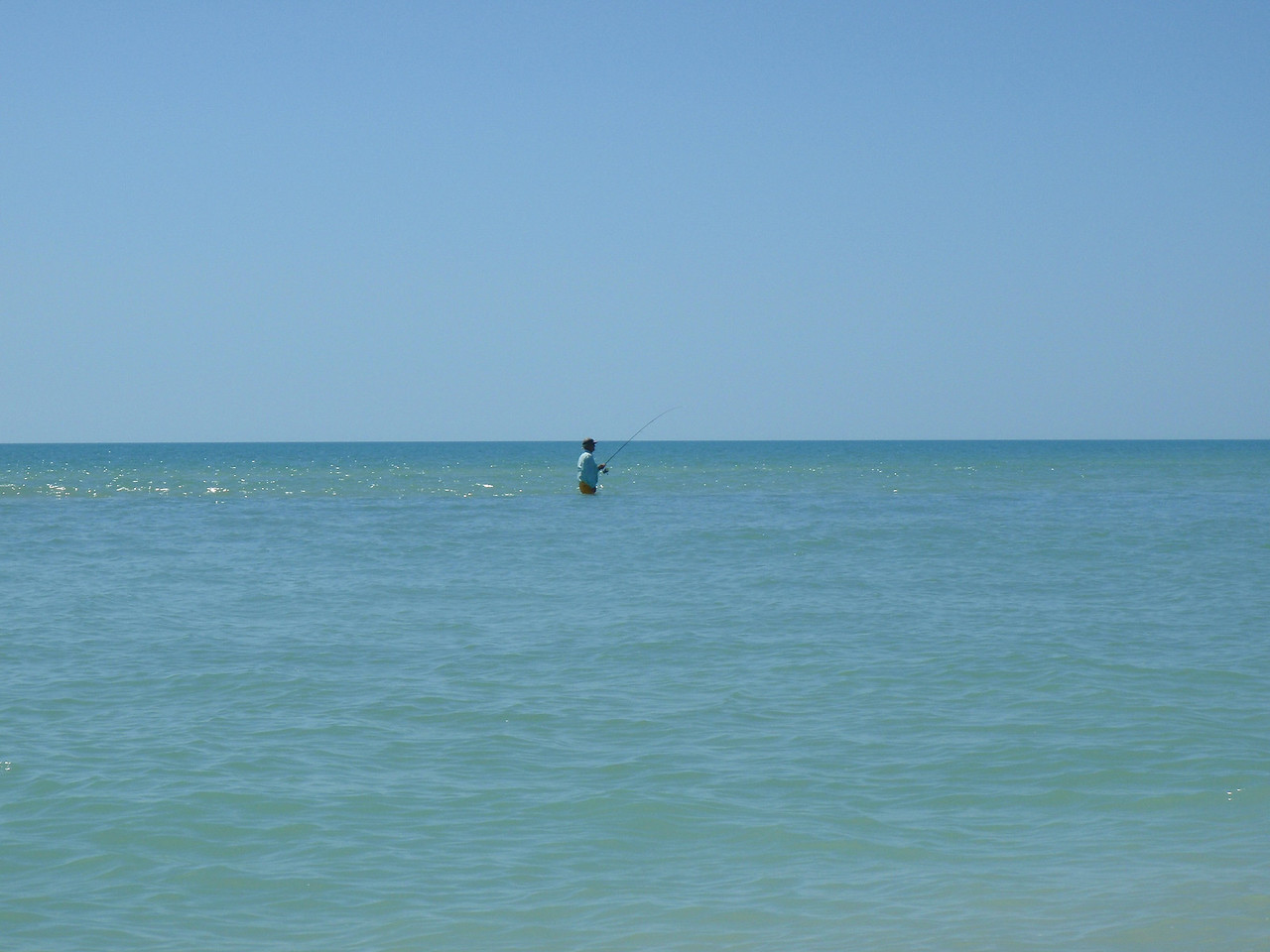 I worked a sandbar drop-off with a small jig tipped off with a piece of shrimp and nailed some big pompano.