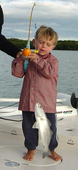 3/16/2005<br /> If you think that I am a crazy fisherman then you have to know that someone has me beat.  These photos are of 2 year old Tanner Little, Wes Little's nephew.  He is the most die-hard fishing loving person I have ever seen.  He will play with his little fishing rod or mess with the baitfish in the live-well all day and never complain.  Eight hours on the boat is not a problem.  Here he is with a spotted trout that he caught all by himself on his mini rod.  He just wipped him into the boat.  He does really catch these fish on the rod that you see, no trick photography.