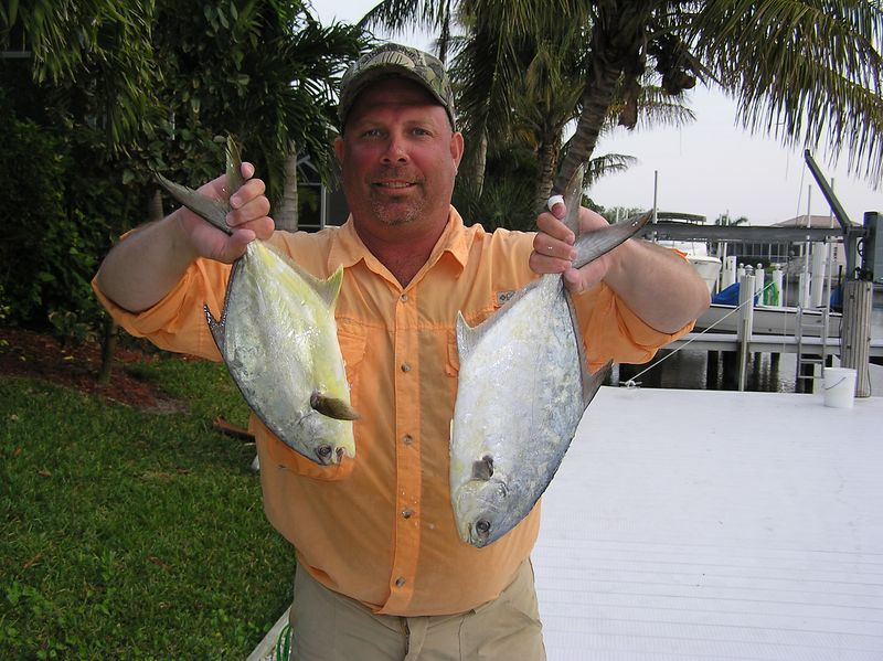 3/14/2005<br /> <br /> Here is Craig Georgi with a couple of pompano from Cape Romano.  We had a good day as mentioned on yesterdays report.<br /> <br /> We had an excellent meal of pompano which are very tasty.