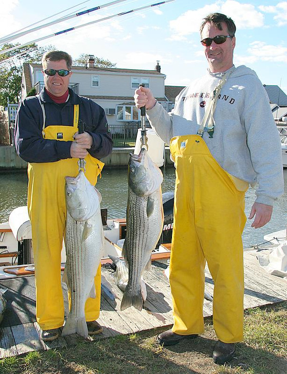 10/26/2006<br /> <br /> Today I fished with Rich and Rick left to right.  We had an excellent day of bass fishing.  We drifted live bait and plugged for at least 10 fish and dropped a bunch more.  Bait schools were numerous and a good number of fish on them.  We had fish to 30 pounds and the weather went from a blow to a real nice day, finally.