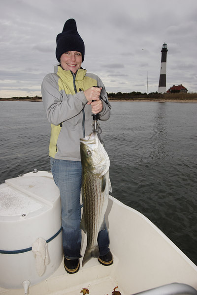 10/27/2006<br /> <br /> Part 2 of my day was with my friend Lisa. After fishing with Al I ran back out with the camera boat and picked her up at Kismet. She snagged her own bait and caught her largest Striper to date. The fish was 22 lbs. After fishing we warmed up at the Kismet Inn over a couple of beers. This is their last weekend of the season...sad to see it end.<br /> <br /> Tim C. Smith