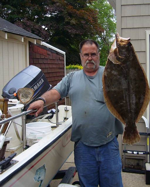 """6-12-2010<br /> <br /> Long time live bait fisherman Lou Peragine Caught this """"Door Mat"""" Fluke just inside the Jones inlet on a Bass Assassin at the top of the flood tide."""